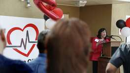 CEO Cynthia Nelson addresses the crowd Friday as San Antonio AIDS Foundation opens an HIV outpatient clinic with a pharmacy on the East Side at 818 E. Grayson Ave.