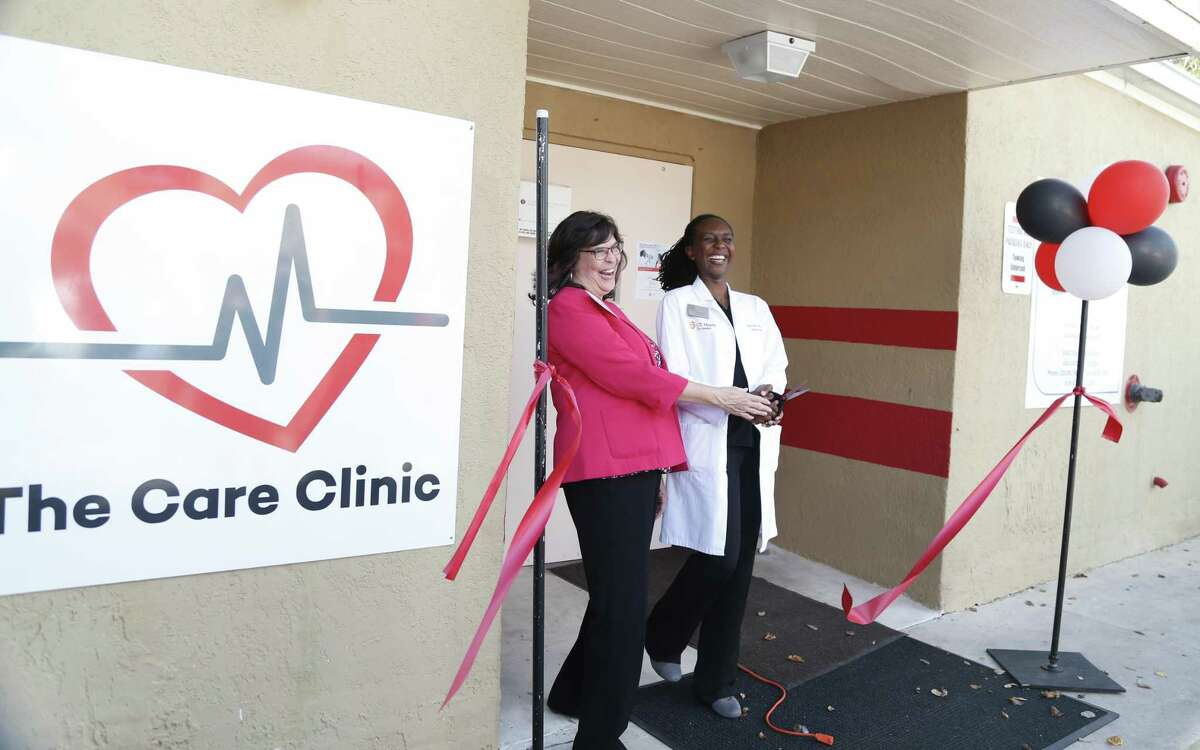SAAF CEO Cynthia Nelson (left) and Dr. Waridibo Allison, who heads the clinic, share a light moment after the ribbon cutting Friday.