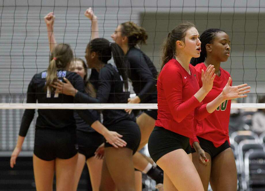 The Woodlands outside hitter Courtney Heiser, center, reacts alongside middle blocker Amanda Ifeanyi after losing to Lewisville Hebron in straight sets during a Class 6A semifinal volleyball match at the UIL state tournament, Friday, Nov. 17, 2017, in Garland. Photo: Jason Fochtman, Staff Photographer / © 2017 Houston Chronicle