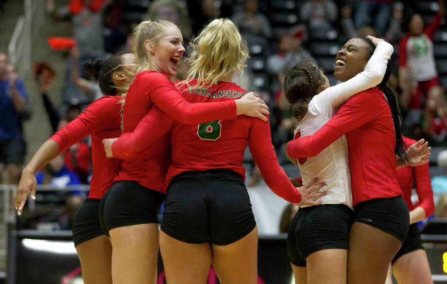 The Woodlands players react after scoring a point during the first set of a Class 6A semifinal volleyball match at the UIL state tournament, Friday, Nov. 17, 2017, in Garland. Photo: Jason Fochtman, Staff Photographer / © 2017 Houston Chronicle