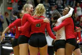 The Woodlands players react after scoring a point during the first set of a Class 6A semifinal volleyball match at the UIL state tournament, Friday, Nov. 17, 2017, in Garland.