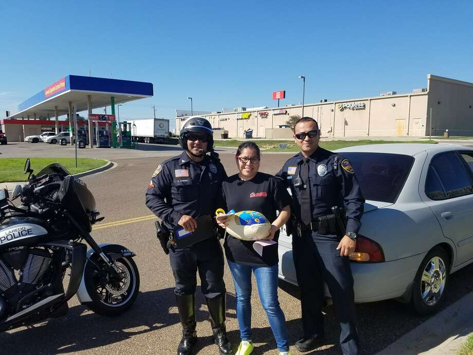In these courtesy photos, Laredo police officers give out turkeys, rather than traffic tickets, to unsuspecting Laredo drivers. The initiative was part of Operation Peacemaker, a nonprofit created by Laredo police officers. Photo: Laredo Police/Courtesy