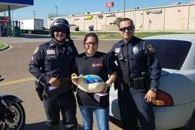 In these courtesy photos, Laredo police officers give out turkeys, rather than traffic tickets, to unsuspecting Laredo drivers. The initiative was part of Operation Peacemaker, a nonprofit created by Laredo police officers.