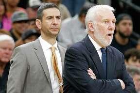 San Antonio Spurs assistant coach James Borrego (left) and head coach Gregg Popovich watch second half action against the Milwaukee Bucks Friday Nov. 10, 2017 at the AT&T Center. The Milwaukee Bucks won 94-87.