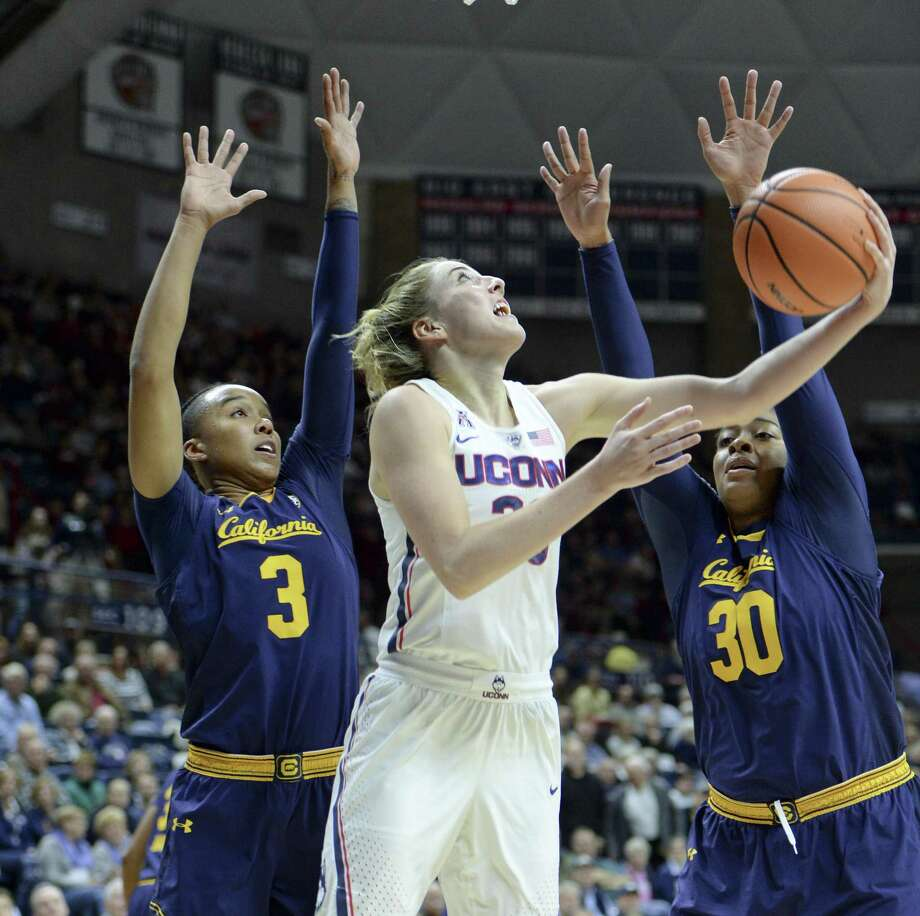 UConn's Katie Lou Samuelson, center, goes up for a shot between California's Mikayla Cowling, left, and CJ West during the first half Friday in Storrs. Photo: Stephen Dunn / Associated Press / FR171426 AP