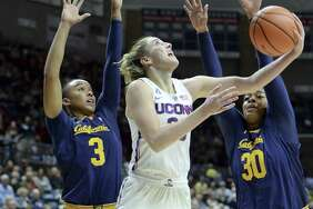UConn's Katie Lou Samuelson, center, goes up for a shot between California's Mikayla Cowling, left, and CJ West during the first half Friday in Storrs.