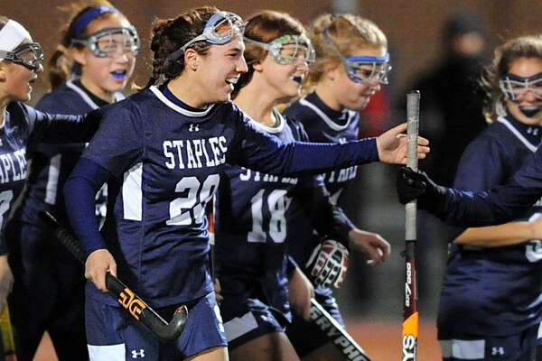 At left, Christine Taylor, (#20) of Staples, is congratulated by teammates after Taylor scored the second goal of the match during the Class L semi-final girls high school field hockey playoff game between Greenwich High School and Staples High School at Brien McMahon in Norwalk, Conn., Tuesday night, Nov. 14, 2017. Staples advanced with a 2-0 victory over Greenwich, Taylor had both goals.