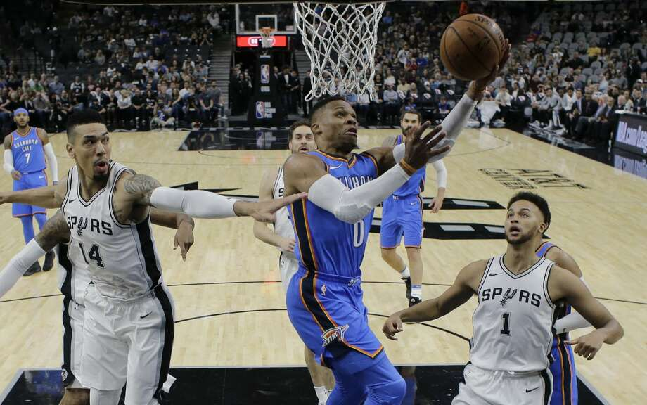 Oklahoma City Thunder guard Russell Westbrook (0) drives to the basket past San Antonio Spurs defenders Danny Green (14) and Kyle Anderson (1) during the first half of an NBA basketball game, Friday, Nov. 17, 2017, in San Antonio. (AP Photo/Eric Gay) Photo: Eric Gay/Associated Press