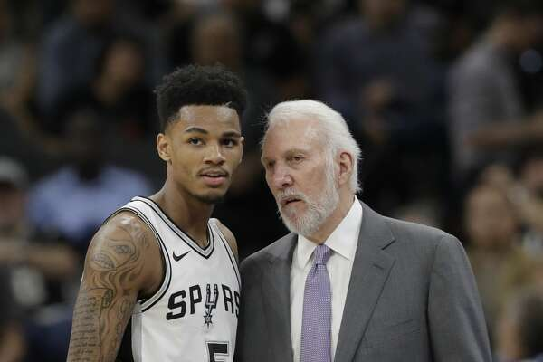 San Antonio Spurs coach Gregg Popovich, right, talks with guard Dejounte Murray during the first half of an NBA basketball game against the Oklahoma City Thunder, Friday, Nov. 17, 2017, in San Antonio. (AP Photo/Eric Gay)