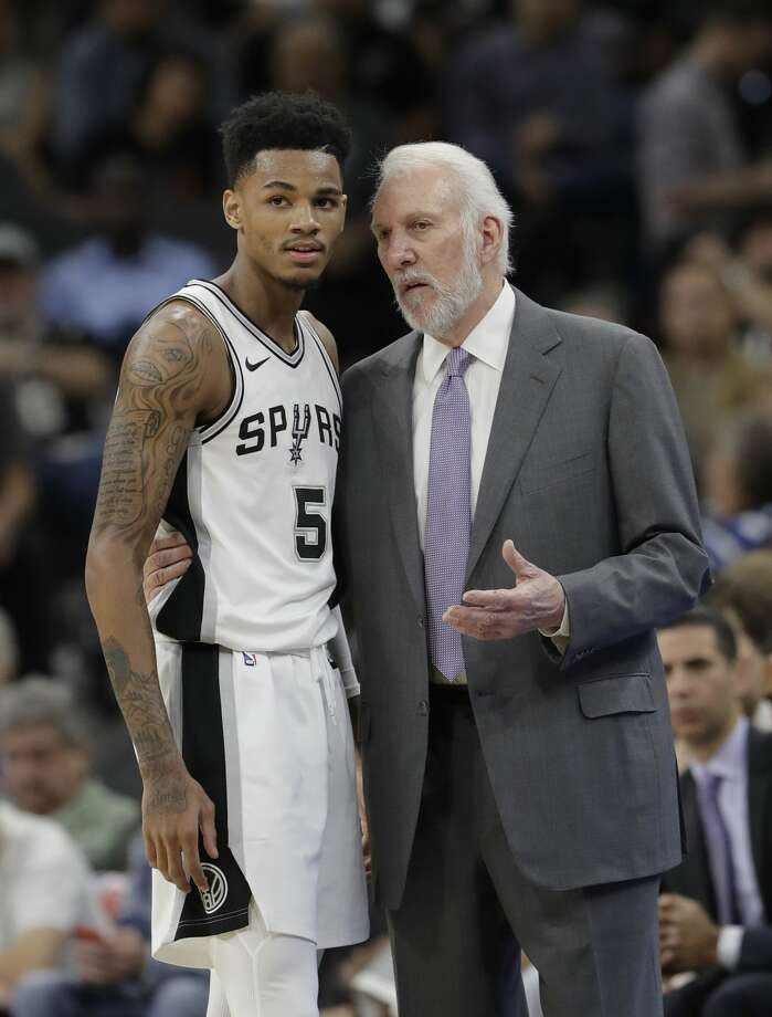 San Antonio Spurs coach Gregg Popovich, right, talks with guard Dejounte Murray during the first half of an NBA basketball game against the Oklahoma City Thunder, Friday, Nov. 17, 2017, in San Antonio. (AP Photo/Eric Gay) Photo: Eric Gay/Associated Press