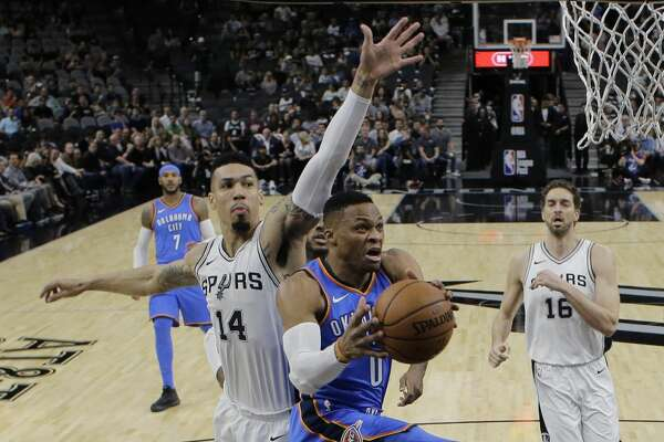 Oklahoma City Thunder guard Russell Westbrook (0) drives to the basket past San Antonio Spurs guard Danny Green (14) during the first half of an NBA basketball game, Friday, Nov. 17, 2017, in San Antonio. (AP Photo/Eric Gay)
