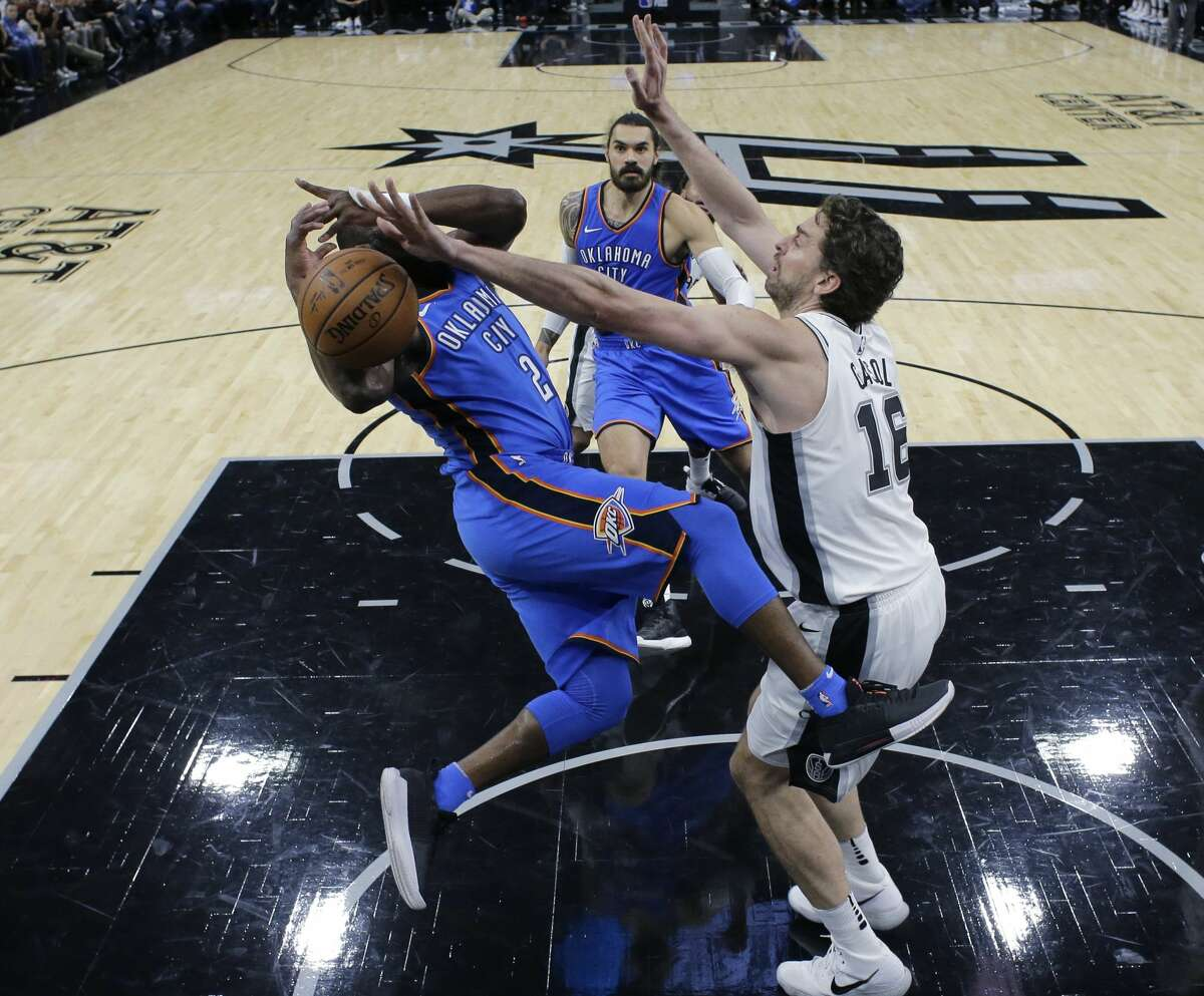 Oklahoma City Thunder guard Raymond Felton (2) is fouled by San Antonio Spurs center Pau Gasol (16) during the first half of an NBA basketball game, Friday, Nov. 17, 2017, in San Antonio. (AP Photo/Eric Gay)