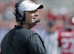 Houston head coach Major Applewhite smiles on the sidelines during the second half of an NCAA college football game against East Carolina, Saturday, Nov. 4, 2017, in Houston. (Michael Wyke/Houston Chronicle via AP)