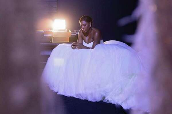Serena Williams shared a photo of herself in her wedding gown on Friday evening, following her Thursday nuptials to Reddit co-founder Alexis Ohanian.
