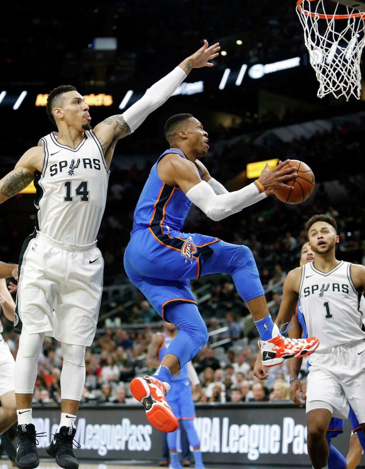 SAN ANTONIO,TX - NOVEMBER 17: Russell Westbrook #0 of the Oklahoma City Thunder drives under Danny Green #14 of the San Antonio Spurs at AT&T Center on November 17, 2017 in San Antonio, Texas. NOTE TO USER: User expressly acknowledges and agrees that , by downloading and or using this photograph, User is consenting to the terms and conditions of the Getty Images License Agreement.