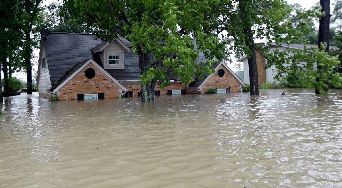 A home in Spring, Texas, is surrounded by floodwaters from Hurricane Harvey on Aug. 28, 2017. (Associated Press)