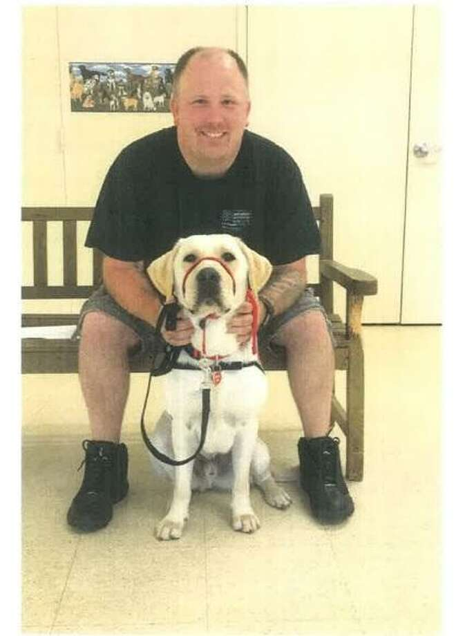 New Haven police  Detective Ryan McFarland and his service dog, Hobbs Photo: Contributed Photo