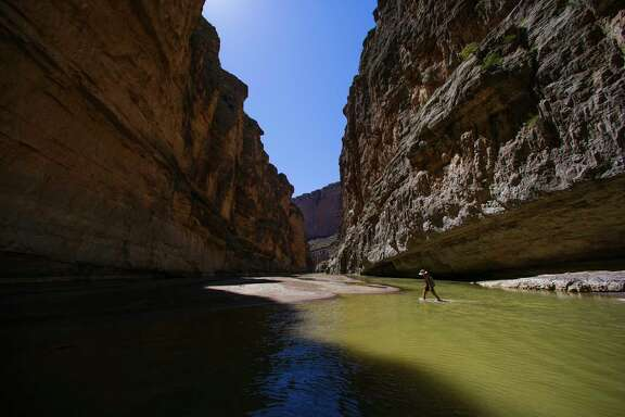 A hiker travels up Santa Elena Canyon through the Rio Grande River in Big Bend National Park. ( Michael Ciaglo / Houston Chronicle)