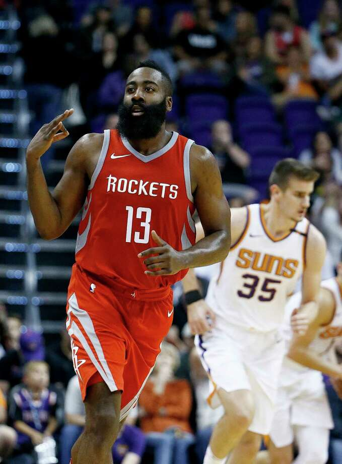 James Harden, left, sees less stress in his future if Chris Paul handles more of the Rockets' playmaking. Photo: Ross D. Franklin, STF / Copyright 2017 The Associated Press. All rights reserved.