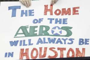 4/28/13: Candy Grasty holds a sign during the Houston Aeros against the Grand Rapids Griffins in the first period in game two of the Western Conference Finals at Toyota Center in Houston, Texas.