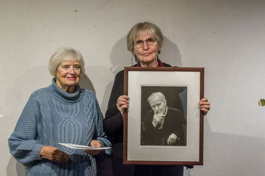Karin Smith's photograph of New Milford artist Woldemar Neufeld was honored at the KAA's by president Connie Horton. Photo: Contributed Photo /Not For Resale /
