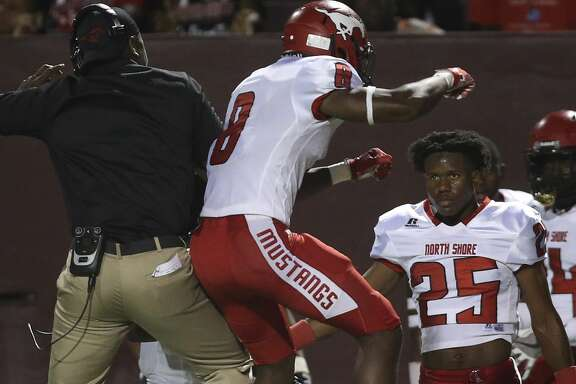 North Shore wide receiver Chance Pillar (8) celebrates a touch down with a coach during the first quarter of the District 22-6A Round One Play-offs game at the Abshier Stadium on Friday, Nov. 17, 2017, in Deer Park. ( Yi-Chin Lee / Houston Chronicle )