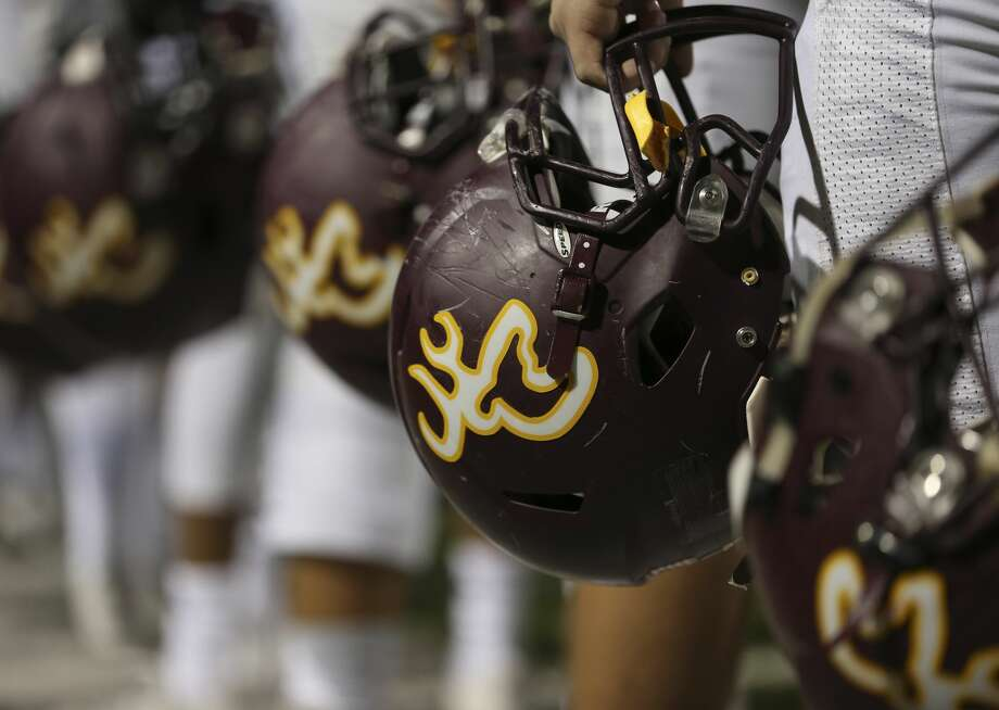 Deer Park players holding their helmets during the opening ceremony of the District 22-6A Round One Play-offs game against North Shore at the Abshier Stadium on Friday, Nov. 17, 2017, in Deer Park. ( Yi-Chin Lee / Houston Chronicle ) Photo: Yi-Chin Lee/Houston Chronicle