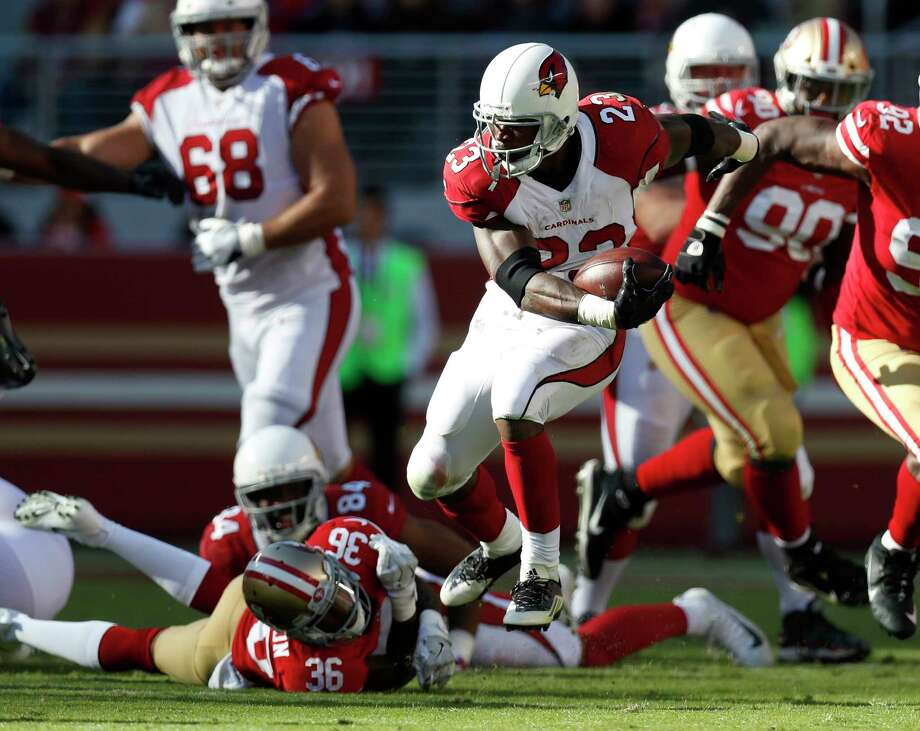 The Cardinals' Adrian Peterson, center, still has the moves and the energy as he proved by running for 159 yards on 37 carries against the 49ers on Nov. 5. Photo: Nhat V. Meyer, MBR / San Jose Mercury News