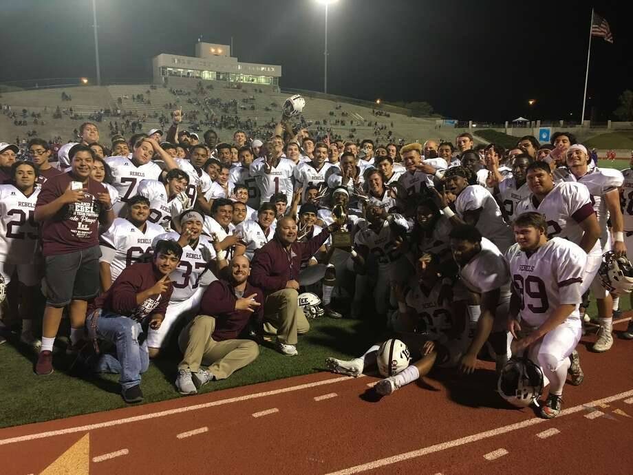 The Lee football team celebrates with its bi-district gold football trophy after blanking El Paso El Dorado 63-0 at Socorro ISD Student Activities Complex on Friday. (Photo by Will Korn | MRT)