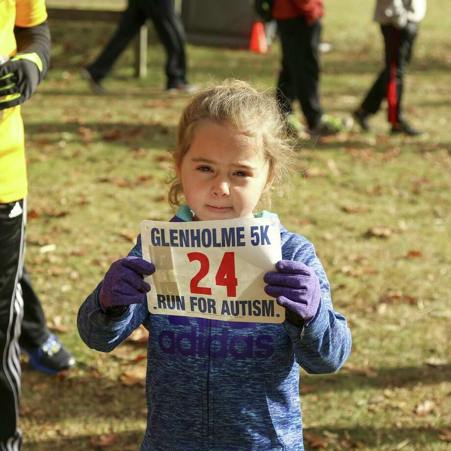 The Glenholme School held its fourth annual 5K Run for Autism on Nov. 12. The proceeds support the schools offering to students through academic innovations and therapeutic program expansion, while helping raise awareness of autism. Sarah Morehouse, one of the youngest racers at age 4, completed the course in under one hour with her father, Andrew Morehouse. Photo: Contributed Photo /Not For Resale