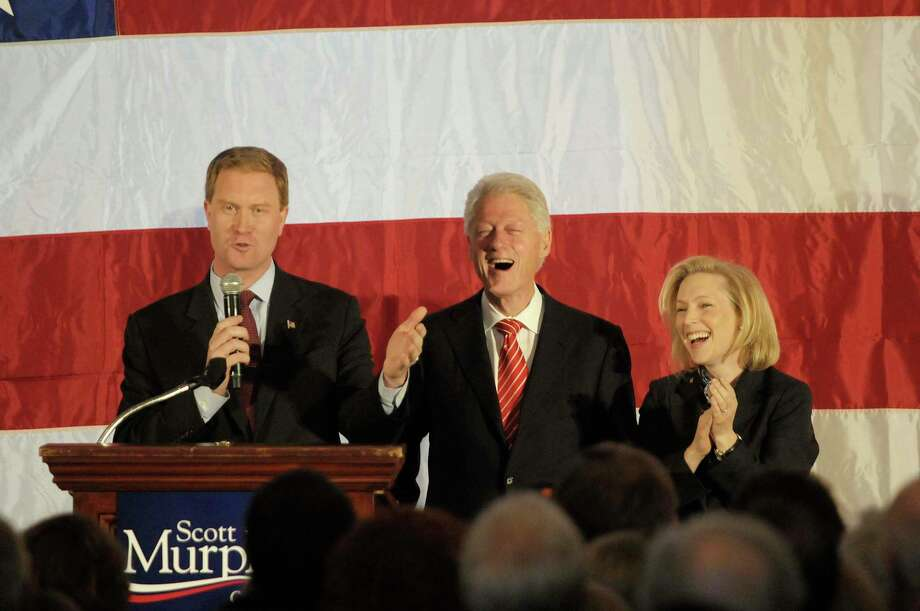 U.S. Congressman Scott Murphy, left, talks about stumping for  former President Bill Clinton, center, when he was first running for President as  U.S. Senator Kirsten Gillibrand, right, looks on, during a political rally at the Hall of Springs in Saratoga Springs, NY on Monday morning, Nov. 1, 2010.  (Paul Buckowski / Times Union) Photo: Paul Buckowski / 00010869A