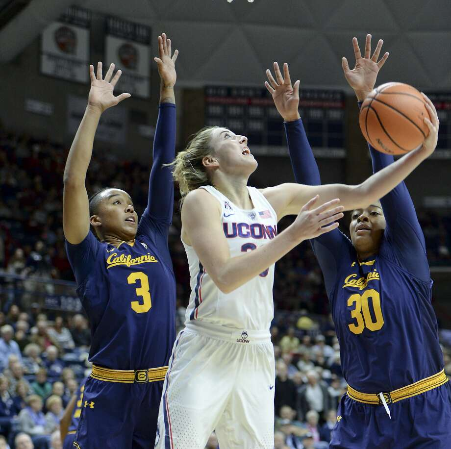 UConn's Katie Lou Samuelson (center) goes up for two points against Cal on Friday. Samuelson was injured in the victory. Photo: Stephen Dunn, Associated Press
