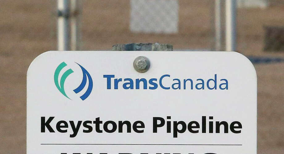 FILE- This Nov. 6, 2015, file photo shows a sign for TransCanada's Keystone pipeline facilities in Hardisty, Alberta, Canada. TransCanada Corp.'s Keystone pipeline leaked oil onto agricultural land in northeastern South Dakota, the company and state regulators said Thursday, Nov. 16, 2017, but state officials don't believe the leak polluted any surface water bodies or drinking water systems. (Jeff McIntosh/The Canadian Press via AP, File) Photo: Jeff McIntosh, SUB / The Canadian Press
