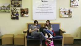 Alex Cantrell, 18, left, and Jade Evenstad, 18, hang out in the Charles L. Cotrell Learning Commons at St. Mary's University, Thursday, Nov. 16, 2017. Both are biology majors at the university.