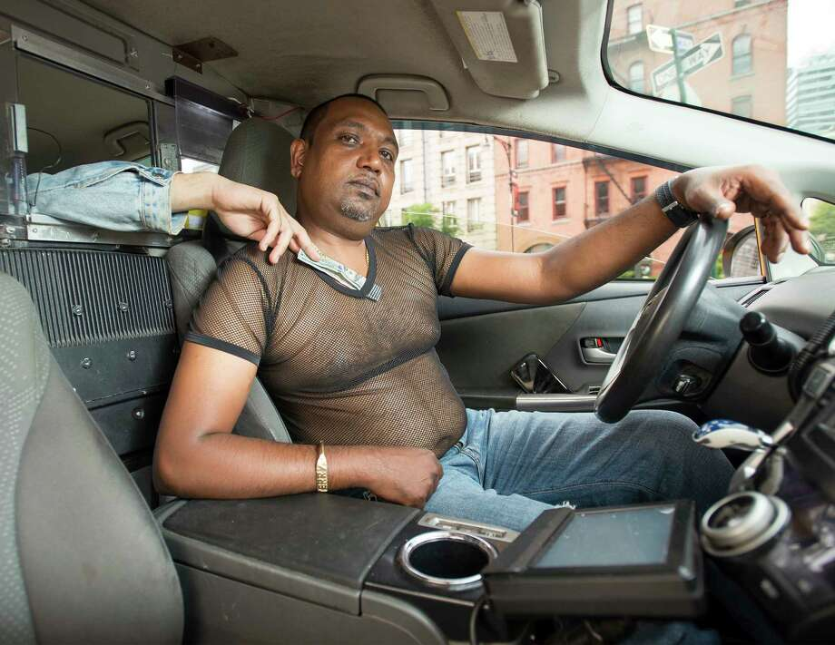 In this photo provided by Shannon Kirkman, taxi driver Terry Samlall poses for the NYC Taxi Drivers calendar in New York. The NYC Taxi Drivers Calendar has twelve New York City cabbies smirking and smoldering their way through 2018 in a tongue-in-cheek pinup calendar that's raising money for a venerable social-service organization. (Shannon Kirkman via AP) ORG XMIT: NYML302 Photo: Shannon Kirkman / Shannon Kirkman