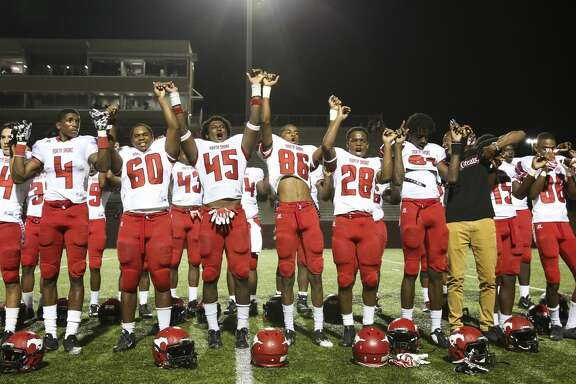 North Shore players celebrate their 48-7 win over Deer Park with their fans after the District 22-6A Round One Play-offs game at the Abshier Stadium on Friday, Nov. 17, 2017, in Deer Park. ( Yi-Chin Lee / Houston Chronicle )