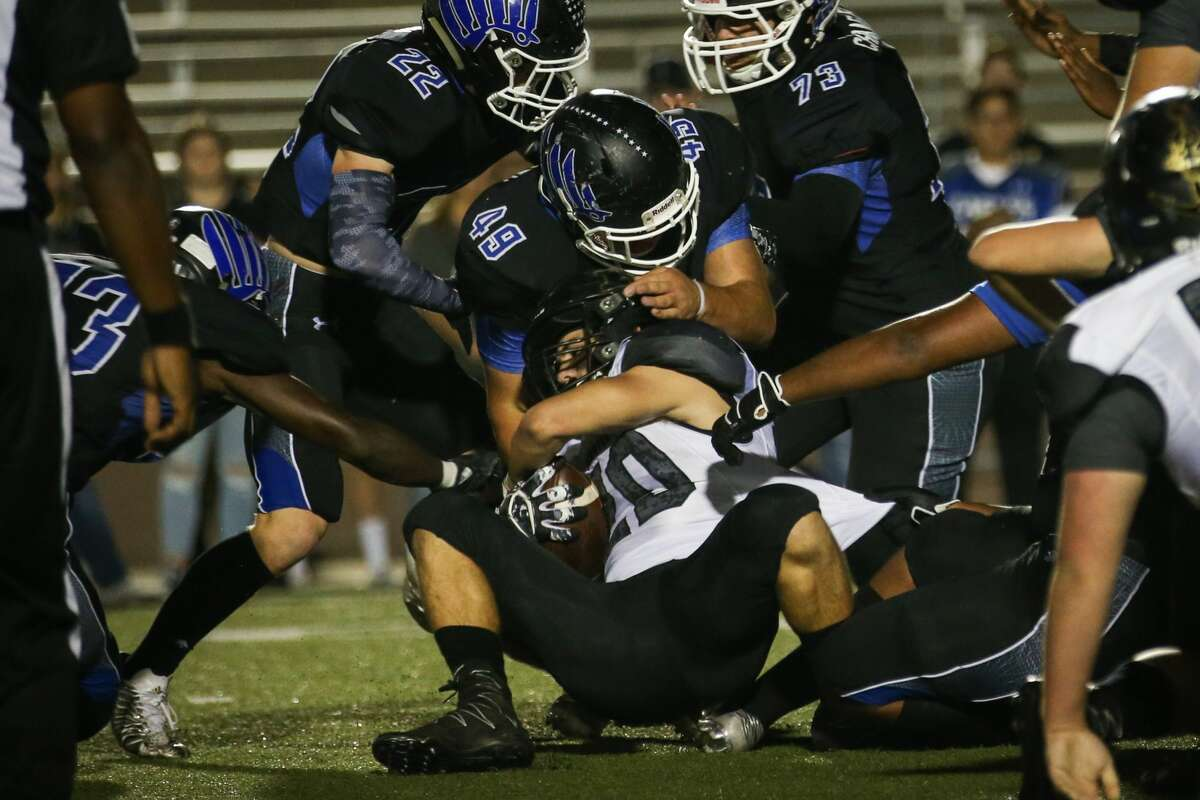 New Caney's Austin Fralick (49) stops Vidor's Hogan Stogner (20) during the varsity football game on Friday, Nov. 17, 2017, at Galena Park ISD Stadium. (Michael Minasi / Houston Chronicle)