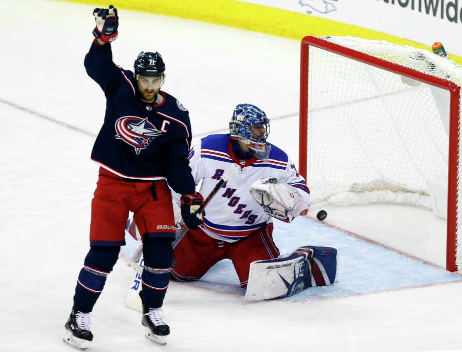 Columbus Blue Jackets forward Nick Foligno, left, reacts in front of New York Rangers goalie Henrik Lundqvist, of Sweden, after a goal by Blue Jackets forward Artemi Panarin, of Russia, during the third period of an NHL hockey game in Columbus, Ohio, Friday, Nov. 17, 2017. (AP Photo/Paul Vernon) ORG XMIT: OHPV112 Photo: Paul Vernon / FR66830 AP