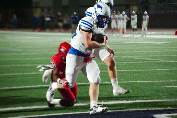 Friendswood's Calvin Whitaker (44) muscles into the end zone past Dawson's Kris Levi (20) Friday, Nov. 17 at Pearland High School.