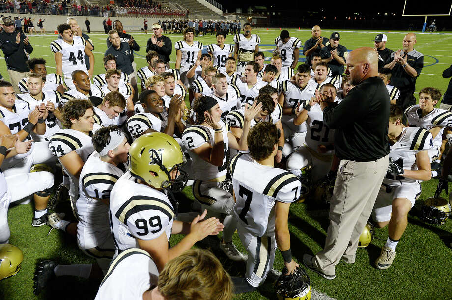 Nederland head coach Monte Barrow talks to his player after they won the 5A bidistrict playoff round against Porter at Ray Maddry Stadium in Channelview on Friday night.  Photo taken Friday 11/17/17 Ryan Pelham/The Enterprise Photo: Ryan Pelham / ©2017 The Beaumont Enterprise/Ryan Pelham