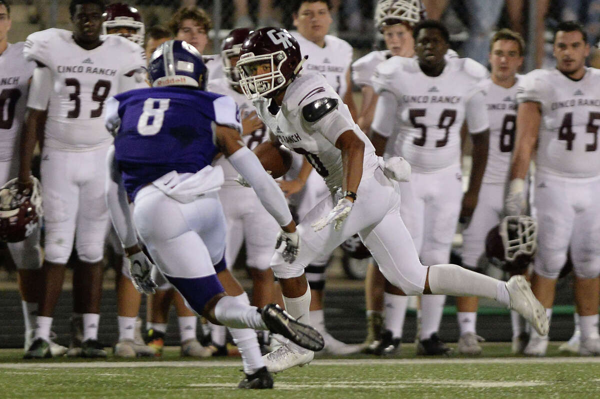 Justin Hull (10) of Cinco Ranch scores on a pass from Zach Easterly (5) in the second quarter of a 6A-III bi-district playoff football game between the Cinco Ranch Cougars and the Ridge Point Panthers on November 17, 2017 at Hall Stadium, Missouri City, TX.