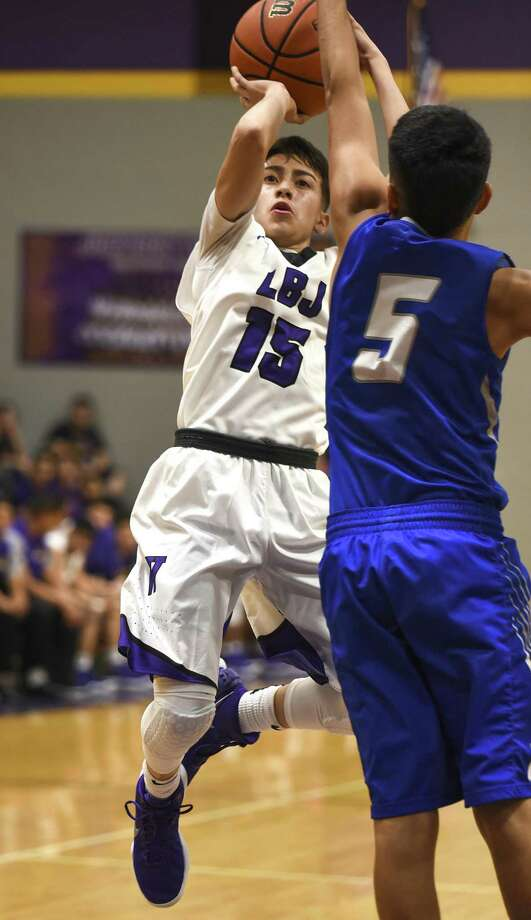 Chris Merino and LBJ broke a team record for points Tuesday beating Crystal City 97-54 in their home opener. Merino reached double figures for the seventh time in nine games and was second on the team with 17 points. Photo: Danny Zaragoza /Laredo Morning Times File
