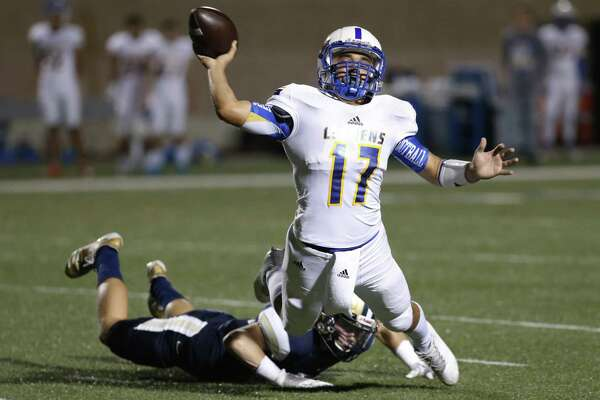 Clemens quarterback Jordan Burleson (17) makes a desperation throw while chased by O'Connor's Grant Rustan (20) during their Class 6A Division I bidistrict high school football playoff game at Farris Stadium on Friday, Nov. 17, 2017. (Kin Man Hui/San Antonio Express-News)
