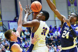 UAlbany's #30 Travis Charles goes to the hoop despite being double teamed by Yale's #4 Noah Yates, left,and #24 Miye Oni, right, during Friday night's game Nov. 17, 2017 in Albany, NY.   (John Carl D'Annibale / Times Union)