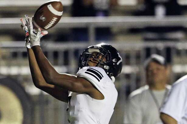 Knight receiver Terrance Ingram stays in stride as he brings down a touchdown pass as Steele plays Brennan at Gustafson Stadium in the first round of 6A football playoffs  on November 17, 2017.