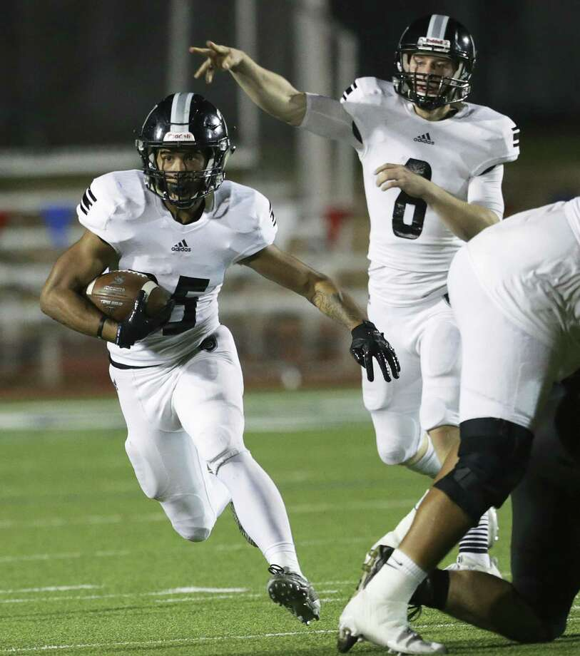Knight quarterback Wyatt Begeal fakes a throw after handing off to Brenden Brady as Steele plays Brennan at Gustafson Stadium in the first round of 6A football playoffs  on November 17, 2017. Photo: Tom Reel, Staff / San Antonio Express-News / 2017 SAN ANTONIO EXPRESS-NEWS