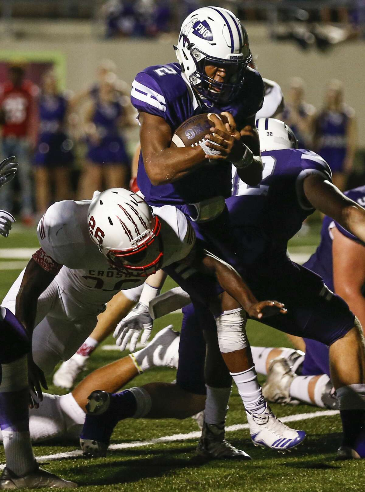 Port Neches-Groves quarterback Roschon Johnson (20 runs past Crosby cornerback An'dre Bruno (26) for a touchdown during the second quarter of a Class 5A bi-district playoff football game at Stallworth Stadium on Friday, Nov. 17, 2017, in Baytown. ( Brett Coomer / Houston Chronicle )