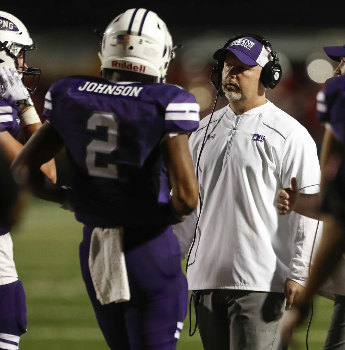Port Neches-Groves head coach Brandon Faircloth talks to quarterback Roschon Johnson during a time out in the second quarter of a Class 5A bi-district playoff football game at Stallworth Stadium on Friday, Nov. 17, 2017, in Baytown. ( Brett Coomer / Houston Chronicle )