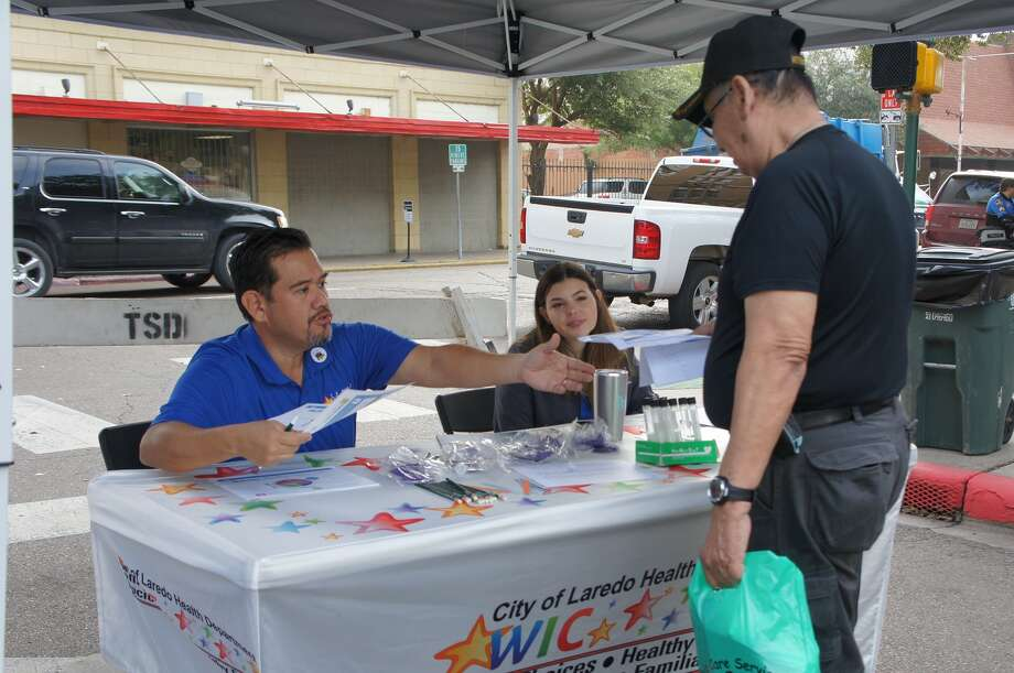 Guillermo Walls from the City of Laredo Health Department assists one of the 32 veterans who attended Thursday's Stand Down for Homeless Veterans event at Jarvis Plaza. About 145 non-veterans were seen as well and provided services during the event. Photo: Courtesy