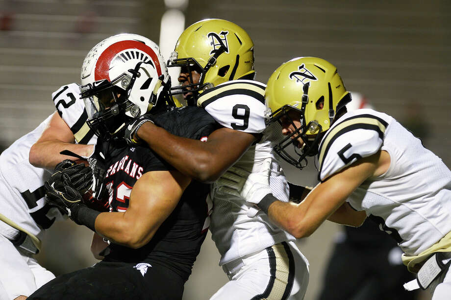 Porter's Joey Corona is tackled by Nederlandé•s Adam Roccaforte, Steven Hendrix and Noah Lewis during the 5A bidistrict playoff round at Ray Maddry Stadium in Channelview on Friday night.  Photo taken Friday 11/17/17 Ryan Pelham/The Enterprise Photo: Ryan Pelham / ©2017 The Beaumont Enterprise/Ryan Pelham